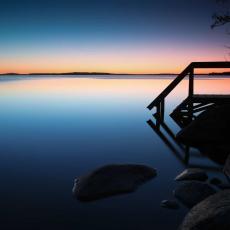 Solnedgång vid piren på Strandängen